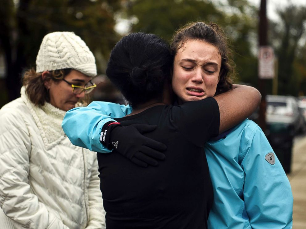 PHOTO: From left, Kate Rothstein looks on as Tammy Hepps hugs Simone Rothstein, after multiple people were shot at The Tree of Life Congregation synagogue, Oct, 27, 2018, in Pittsburgh.