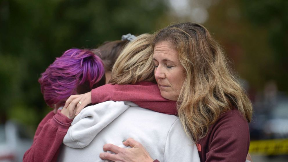 From left, Cody Murphy, 17 Sabrina Weihrauch, and Amanda Godley, left, comfort one another after an active shooter situation at Tree of Life Synagogue in Pittsburgh, Oct. 27, 2018.