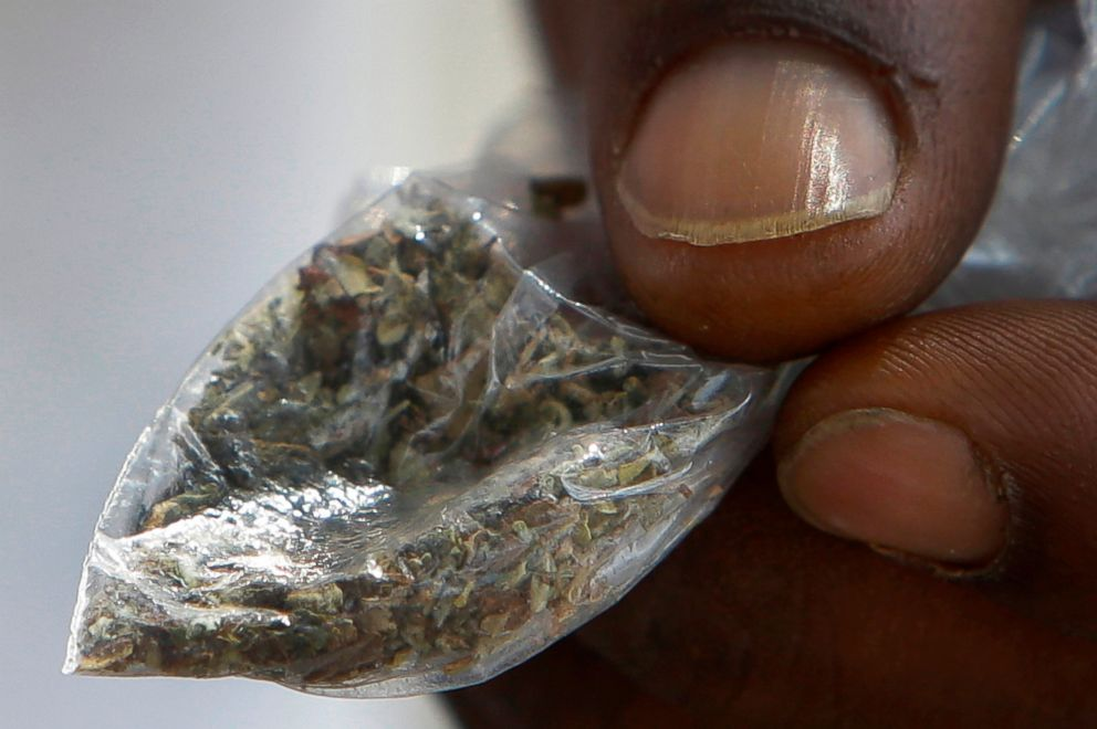 PHOTO: A man holds a bag of synthetic marijuana in Houston, in this June 29, 2016 file photo.