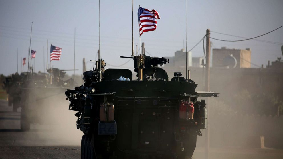 A convoy of US forces drive near the village of Yalanli, on the western outskirts of the northern Syrian city of Manbij,  March 5, 2017.