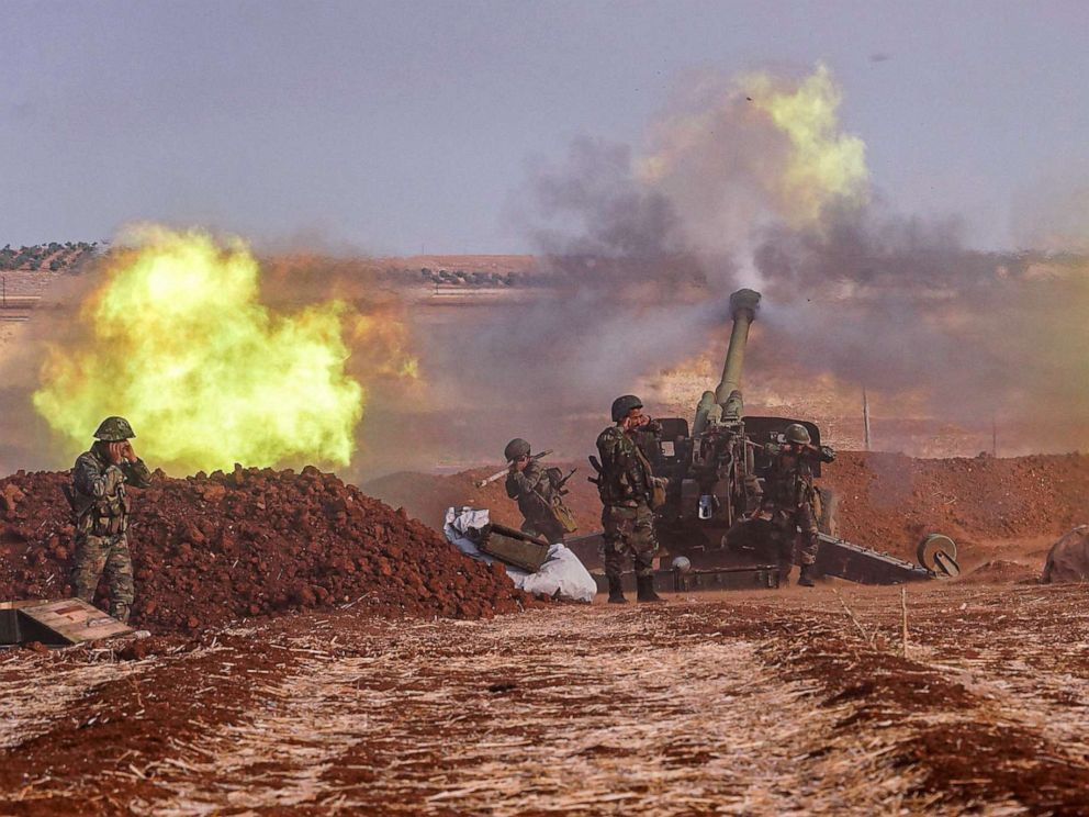 PHOTO: A handout picture released by the official Syrian Arab News Agency (SANA), Oct. 22, 2019 shows Syrian army artillery guns firing from a position in al-Habit on the southern edges of the Idlib province.