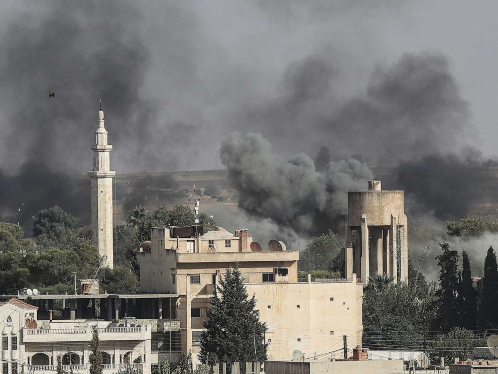 PHOTO: Smoke rises over the Syrian town of Ras al-Ain, as seen from the Turkish border town on October 09, 2019, in Ceylanpinar, Turkey.