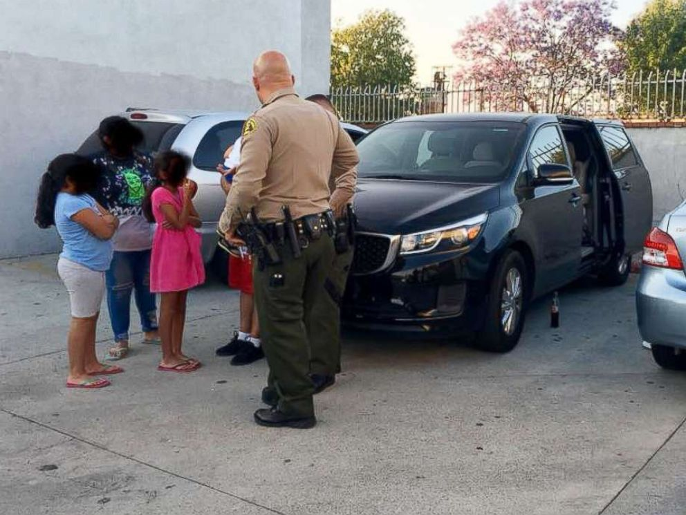 PHOTO: A family of six that was accosted by an armed man while eating a meal in a vehicle parked in City of Industry, Calif., June 10, 2018 is pictured speaking to law enforcement.