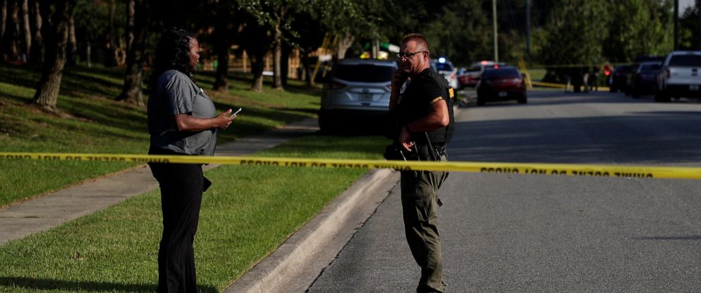 PHOTO: A woman talks to an officer on scene after a relative was stabbed before a job interview at Dyke Industries on Sept. 11, 2019, in Tallahassee, Fla.