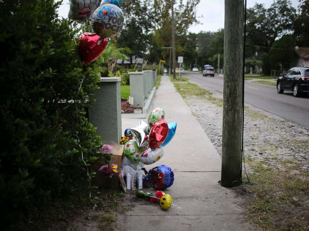 PHOTO: Balloons and candles seen along 15th Street on Oct. 23, 2017 where Anthony Naiboa, 20, was found dead on Oct. 19 in Southeast Seminole Heights in Tampa, Fla.