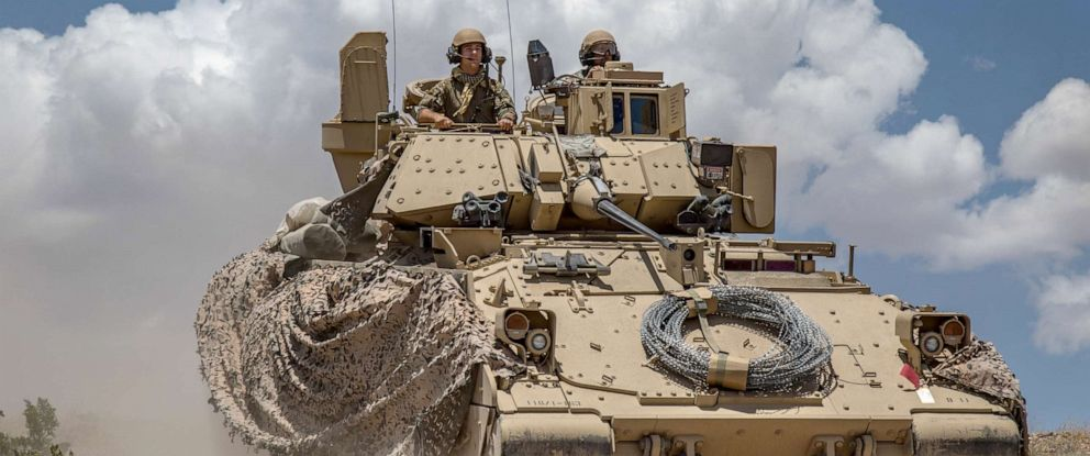 PHOTO: Soldiers from 1st Battalion, 163rd Cavalry Regiment, Montana Army National Guard, push on in their Bradley Fighting Vehicle during a defensive attack training exercise at the National Training Center (NTC) in Fort Irwin, Calif., June 1, 2019.