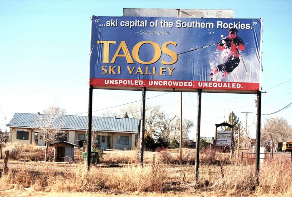 PHOTO: A billboard for the Taos Ski Valley in New Mexico faces the barren February 9, 2000.