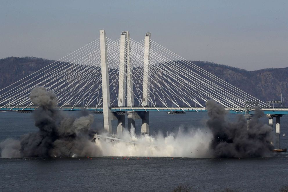PHOTO: The east anchor span of the old Tappan Zee Bridge is demolished by explosives into the Hudson River in front of the new Mario Cuomo Bridge in Tarrytown, N.Y., Jan. 15, 2019.