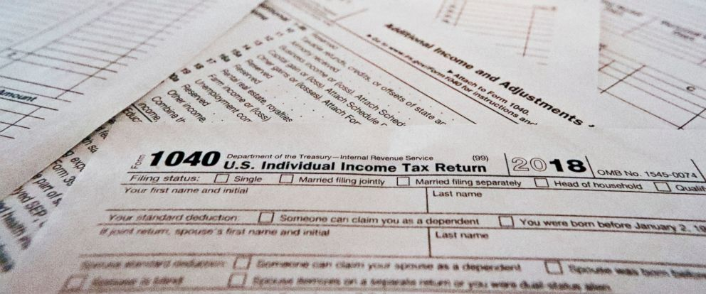 PHOTO: This photo shows multiple forms printed from the Internal Revenue Service web page that are used for 2018 U.S. federal tax returns.