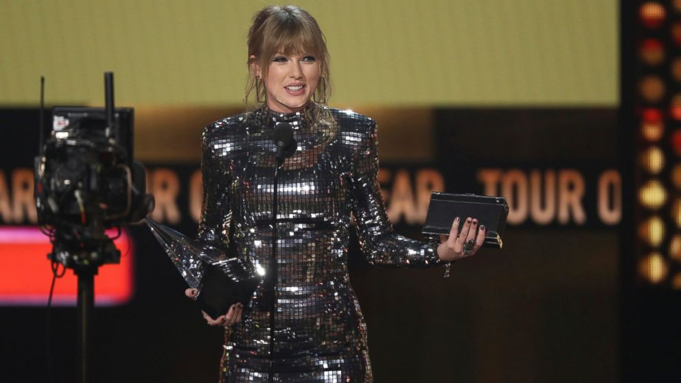 Taylor Swift accepts the award for tour of the year at the American Music Awards on Tuesday, Oct. 9, 2018, at the Microsoft Theater in Los Angeles.