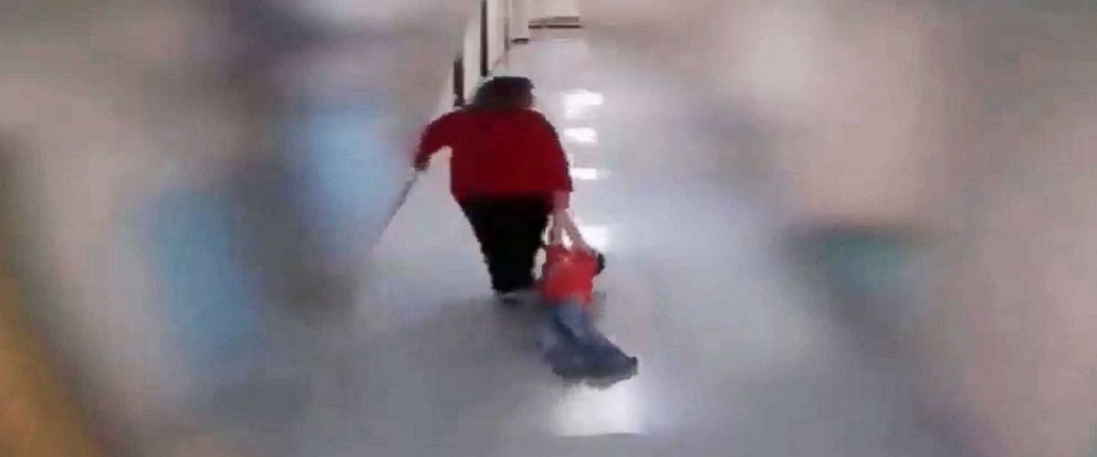 PHOTO: Surveillance video posted to Facebook by Angel Nelson shows her son Alan, 9, as he is dragged through the hall of Wurtland Elementary School in Greenup County, Ky., by a former teacher.