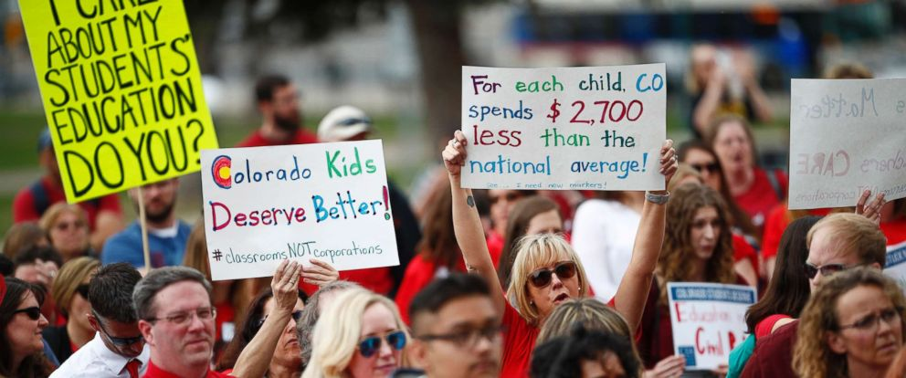 PHOTO: Teachers hold placards during a rally outside the state Capitol, April 16, 2018, in Denver.