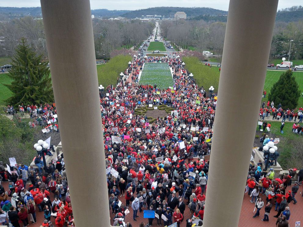PHOTO: Thousands of teachers from across Kentucky gather outside the state Capitol to rally for increased funding and to protest last minute changes to their state funded pension system, April 2, 2018, in Frankfort, Ky.
