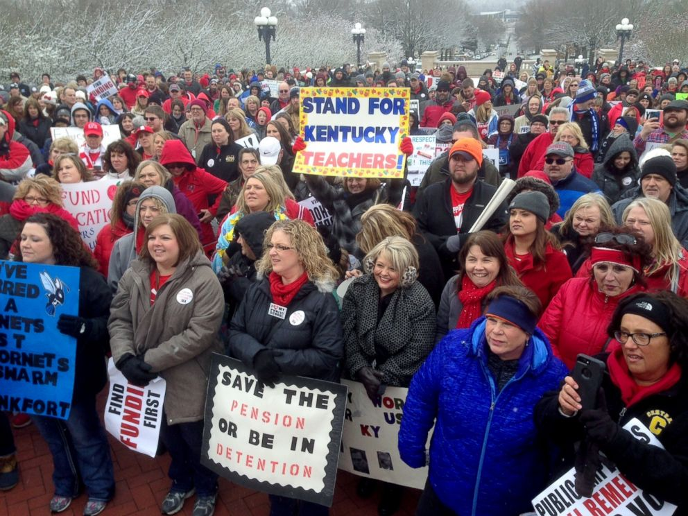 PHOTO: Teachers and other school workers rally against a proposed pension overhaul bill outside the state Capitol, March 21, 2018, in Frankfort, Ky.