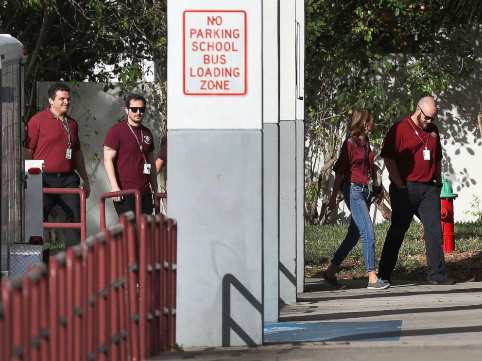 PHOTO: People arrive at Marjory Stoneman Douglas High School as teachers and staff are allowed to return to the school for the first time since the mass shooting on campus, Feb. 23, 2018 in Parkland, Florida.