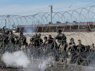 PHOTO: U.S. soldiers and U.S. border patrol officers fire tear gas towards migrants from the U.S.side of the border fence between Mexico and the United States in Tijuana, Mexico, Nov. 25, 2018.