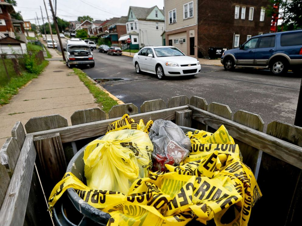 PHOTO: Crime scene tape is in a trash bin along Grandview Ave., on June 20, 2018, in East Pittsburgh, Pa.