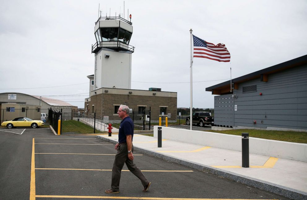 PHOTO: Flight instructor John Singleton, center, walks outside Beverly Regional Airport in Beverly, Mass. on Sep. 10, 2018. Singleton helped to talk Maggie Taraska, 17, down during her emergency landing the previous day at Beverly Regional Airport.