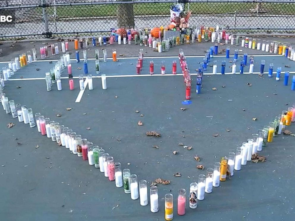 PHOTO: Candles are placed in the shape of a heart on a basketball court in Queens, New York, to honor a 14-year-old who was killed by a stray bullet on Saturday, Oct. 26.