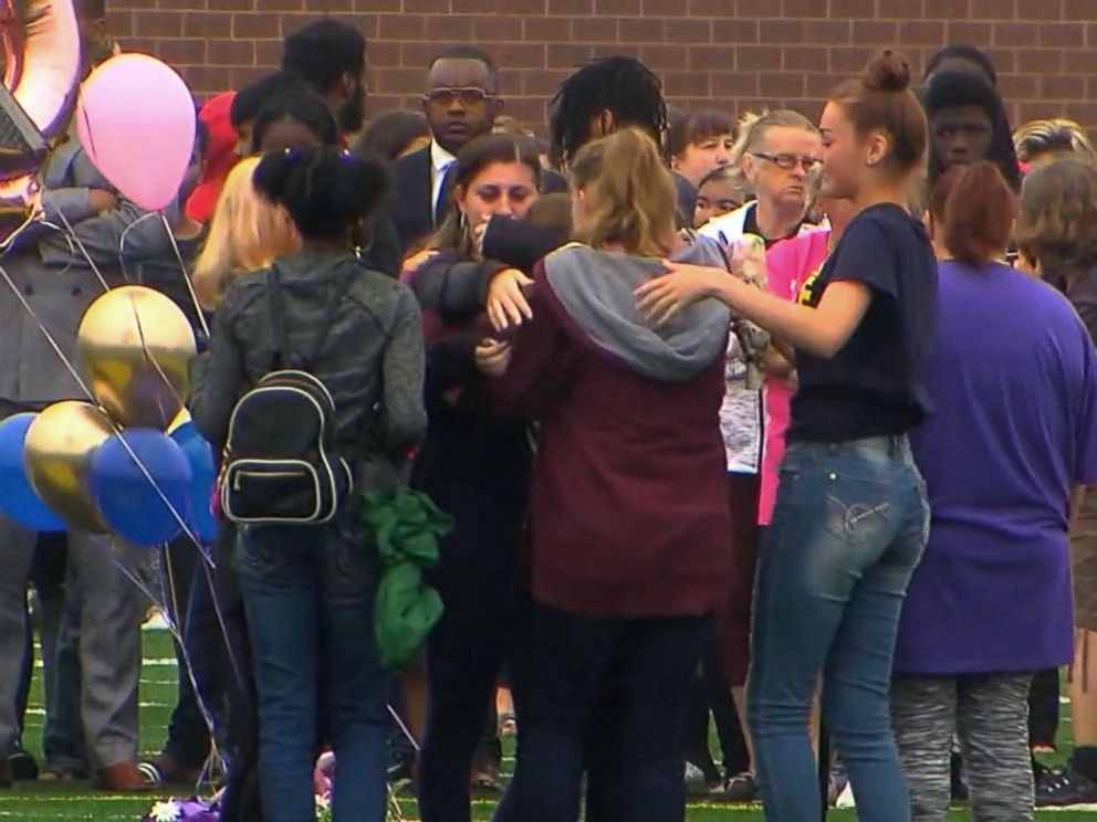 PHOTO: People gather at a vigil for a student who was fatally stabbed in a classroom at Fitzgerald High School in Warren, Mich., Sept. 13, 2018.