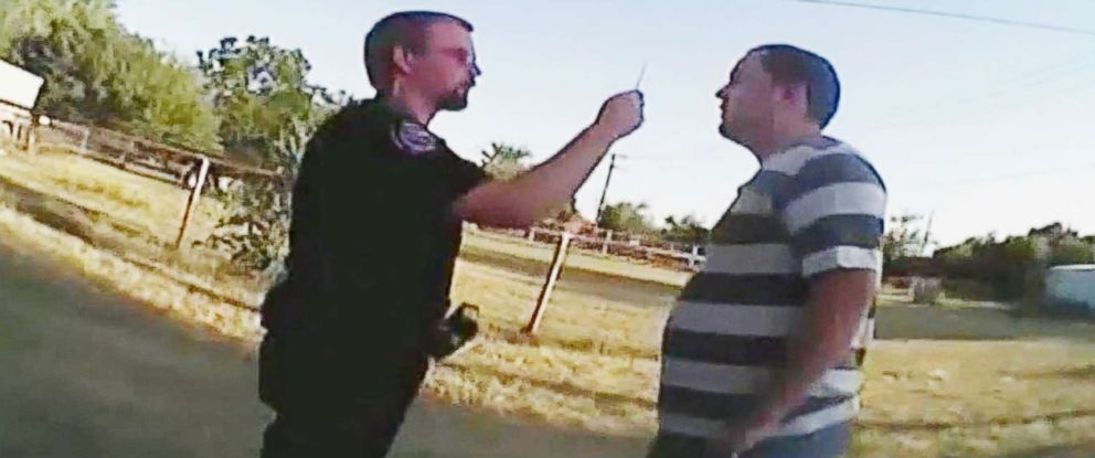 PHOTO: An officer is seen administering a field sobriety test to Michael Moore, who has autism.