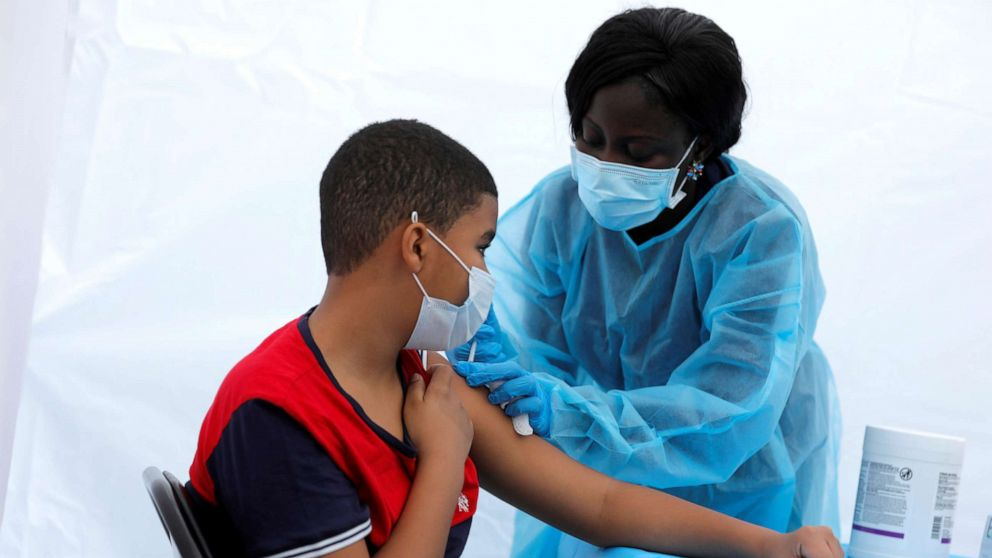 A 12-year-old receives a dose of the Pfizer-BioNTech vaccine for COVID-19 during a vaccination event in New York, June 4, 2021.