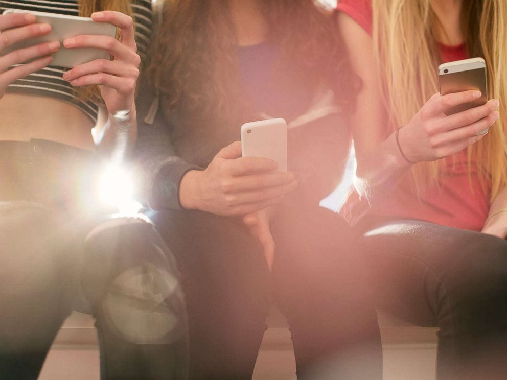 PHOTO: A group of teenage girls are pictured texting on their phones in this undated stock photo.