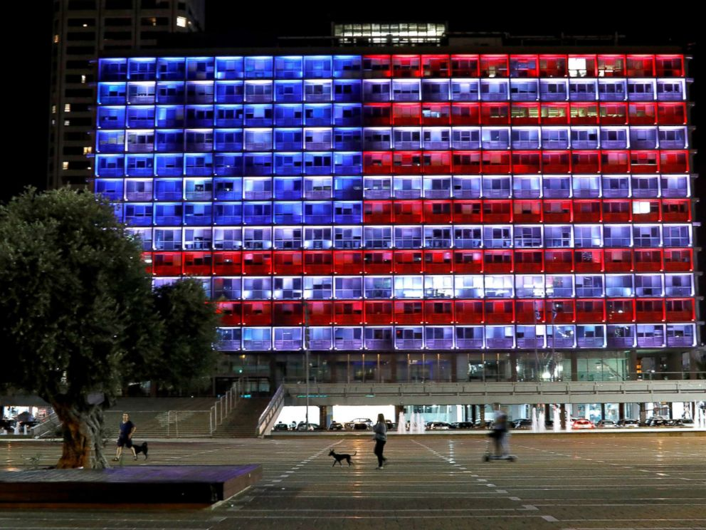 PHOTO: People walk by as the municipality building in Tel Aviv, Israel, is lit in the colors of the American flag in solidarity with the victims of the Pittsburgh synagogue attack, Oct. 27, 2018.