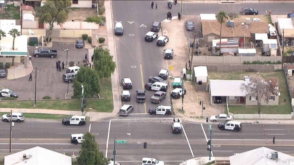 PHOTO: Police surround the area where an officer shot and killed Antonio Arce, 14, when he was allegedly stealing a car in Tempe, Arizona, on Tuesday, January 15, 2019.
