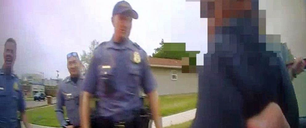 PHOTO: An image made from bodycam video shows police officers apprehending a ten-year-old boy driving a stolen car belonging to his aunt after he led them on a chase in Oklahoma City, April 23, 2019.