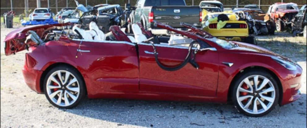 PHOTO: A Tesla Model 3 with extensive roof damage photographed at a tow yard after a crash in March 2019.