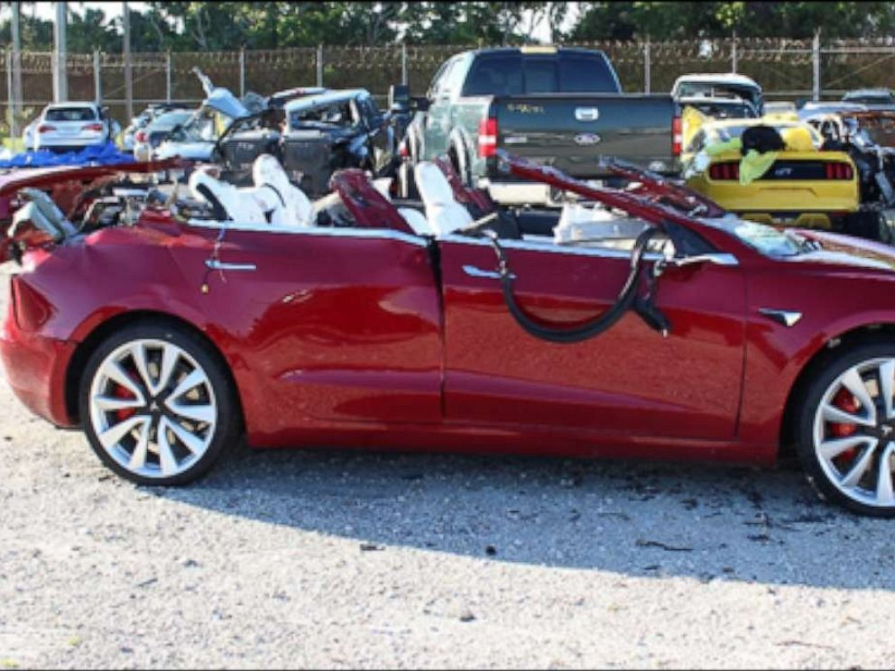 PHOTO: A Tesla Model 3 with extensive roof damage photographed at a tow yard after Jeremy Banner crashed while in autopilot mode in Palm Beach County, Florida, on March 1, 2019.