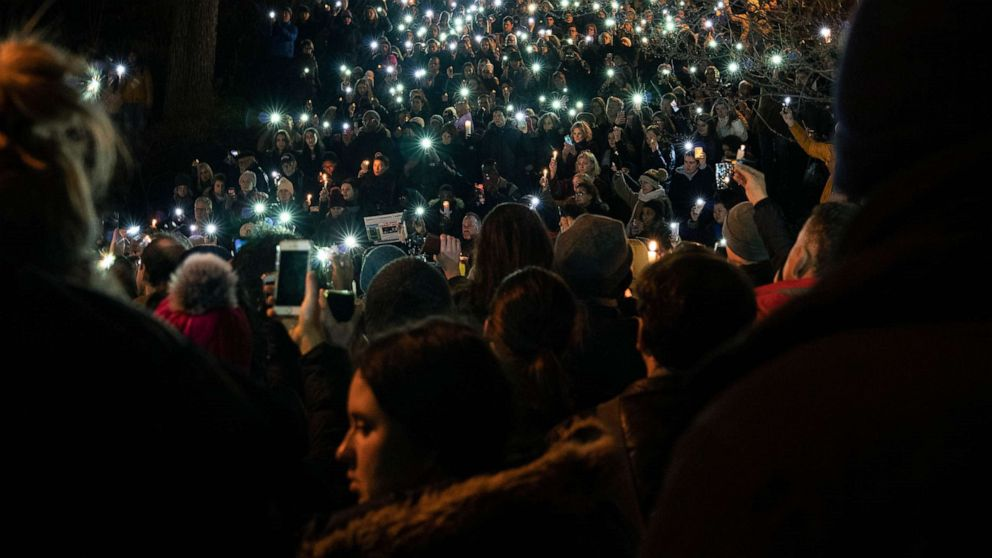 Politicians promise a safer park at vigil for slain college student