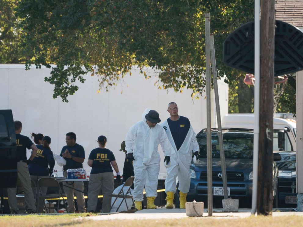 PHOTO: Members of the FBI walk behind the First Baptist Church of Sutherland Springs after a fatal shooting, Nov. 5, 2017, in Sutherland Springs, Texas.