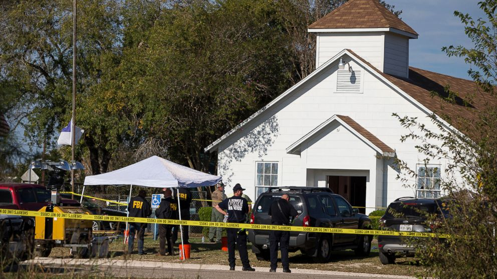 Law enforcement officials works at the scene of a fatal shooting at the First Baptist Church in Sutherland Springs, Texas, Nov. 5, 2017.