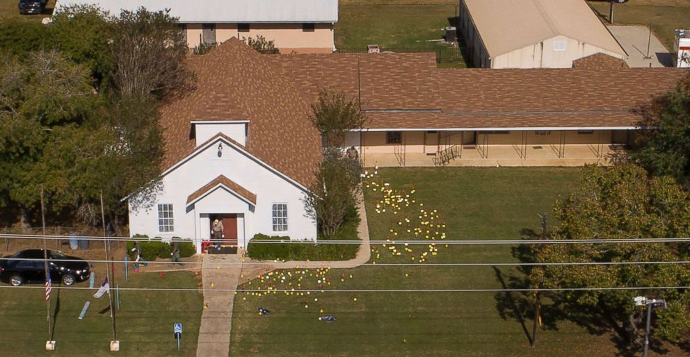 Flags mark evidence on the lawn of the First Baptist Church in Sutherland Springs, Texas, Nov. 6, 2017, a day after the mass shooting.