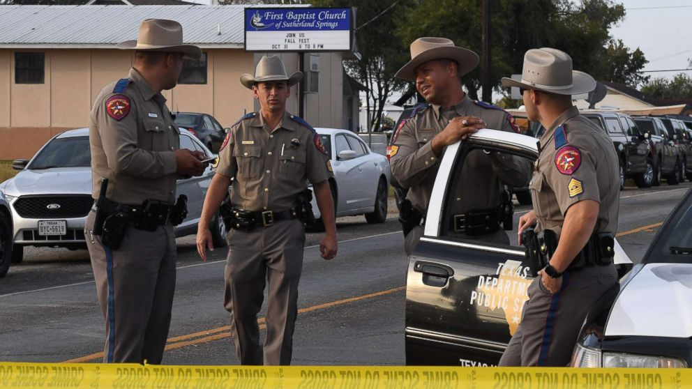 State troopers guard the entrance to the First Baptist Church after a mass shooting that killed 26 people in Sutherland Springs, Texas, Nov. 6, 2017.