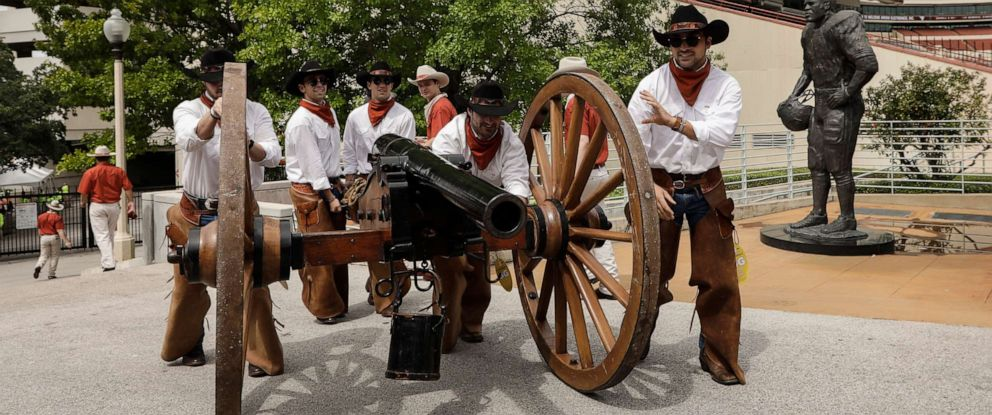 PHOTO: Members of the Texas Cowboys push Smokey the Cannon to the stadium before the game between the Texas Longhorns and the TCU Horned Frogs at Darrell K Royal-Texas Memorial Stadium in this Sept. 22, 2018 file photo in Austin, Texas.