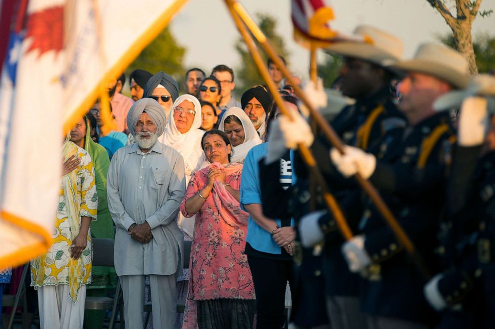 PHOTO: The family of Harris County Deputy Sandeep Dhaliwal watches as an honor guard begins a vigil to honor Dhaliwal in Houston, Texas, Sept. 30, 2019.