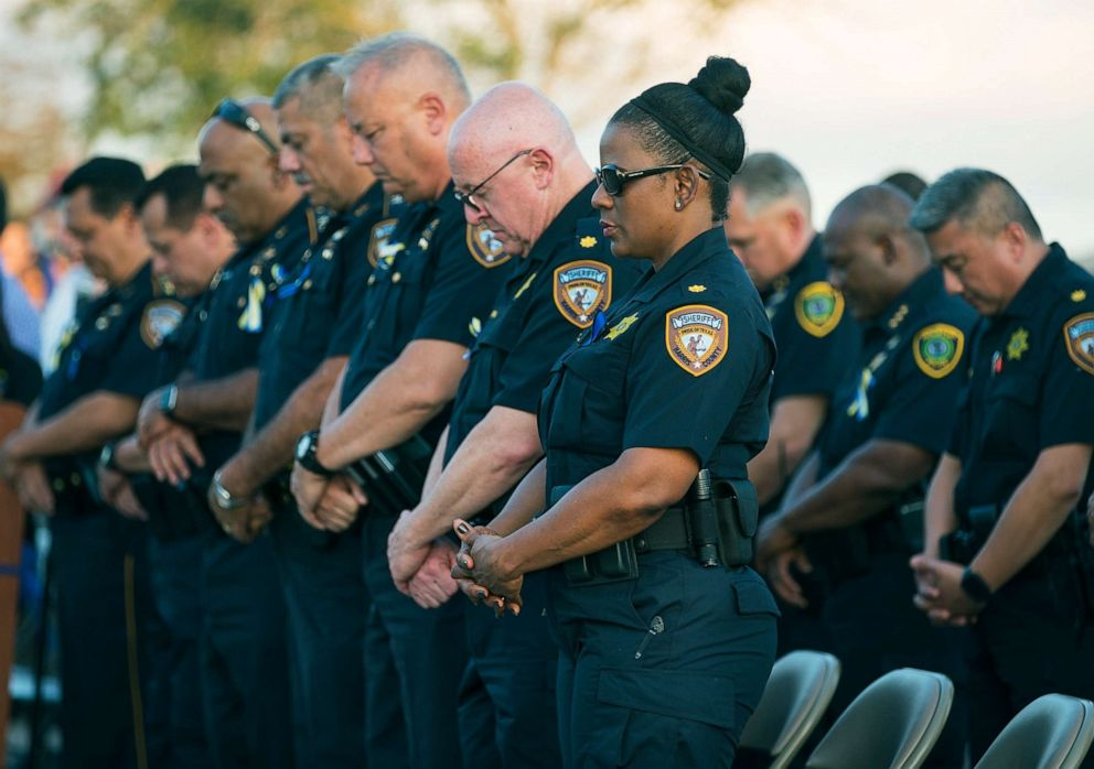 PHOTO: Harris County Sheriffs Office deputies bow their heads in prayer during a vigil for Harris County Sheriffs Office Deputy Sandeep Dhaliwal in Houston, Texas, Sept. 30, 2019.