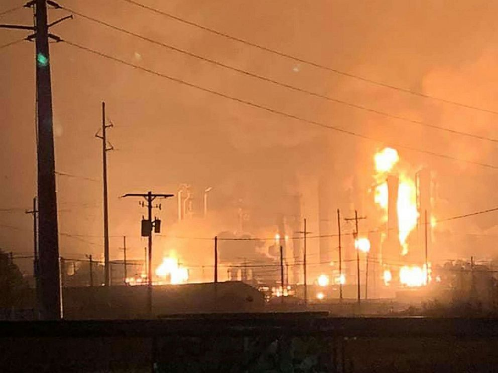 PHOTO: This handout image taken early on November 27, 2019 and released to AFP by Ryan Mathewson shows fire and flames following an explosion at a chemical plant in the Texas city of Port Neches. (Photo by Handout / Courtesy of Ryan Mathewson / AFP)