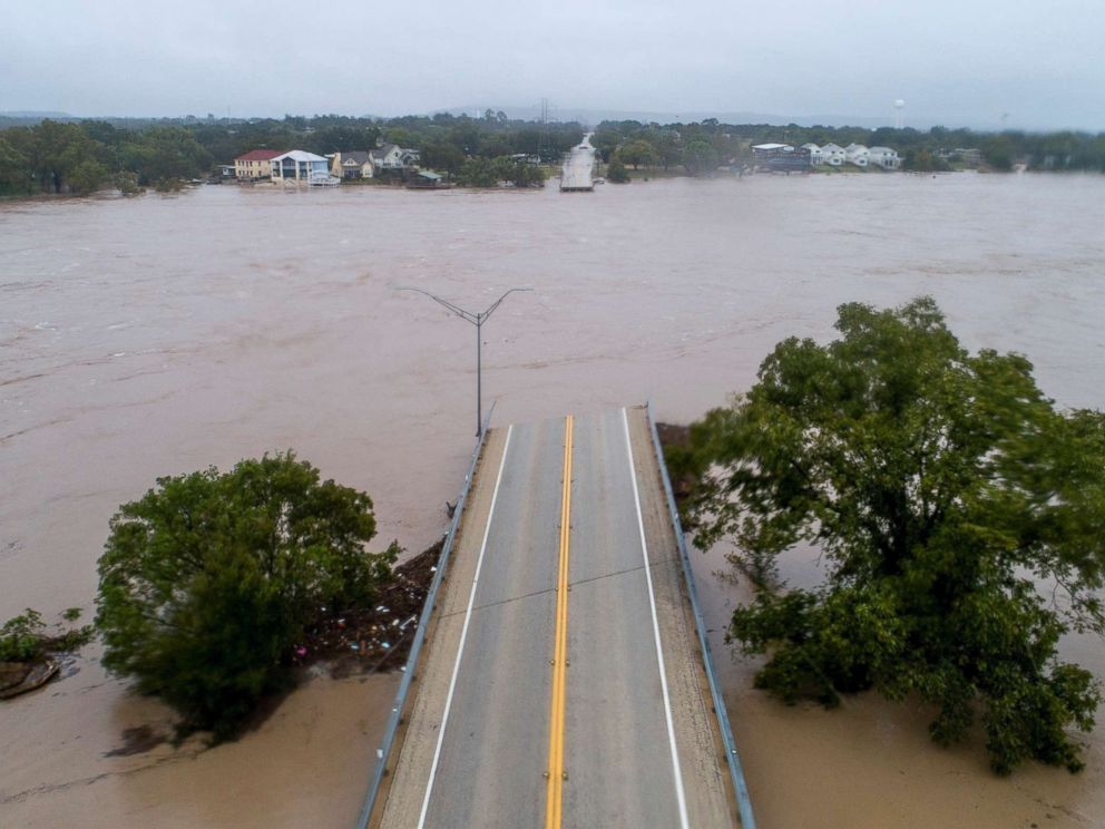 PHOTO: The Llano River flows between the washed out Ranch Road 2900 bridge, Oct. 16, 2018, in Kingsland, Texas.