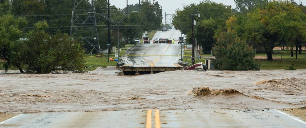 PHOTO: The Llano River flows between to sides of Ranch Road 2900 after the bridge was washed out due to flooding Tuesday, Oct. 16, 2018, in Kingsland, Texas.