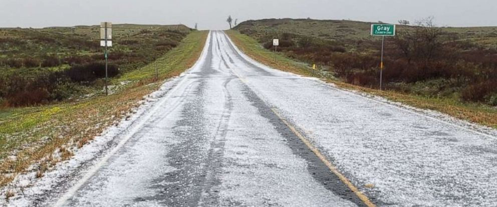 PHOTO: Hail accumulated on Highway 273 south of McLean, Texas, on Wednesday, April 17, 2019.