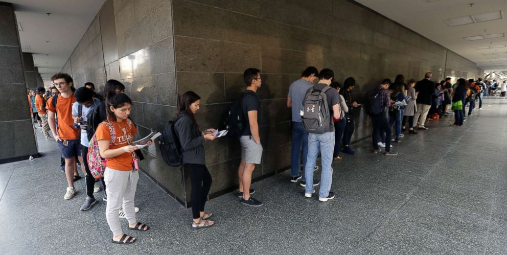 PHOTO: A line of students wait to vote at a Texas primary election polling site on the University of Texas campus in Austin, Texas, March 6, 2018.
