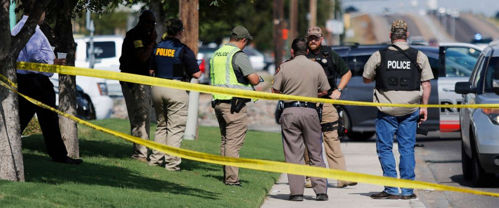 PHOTO: Authorities cordon off a part of the sidewalk in Odessa, Texas, after a mass shooting on Aug. 31, 2019.