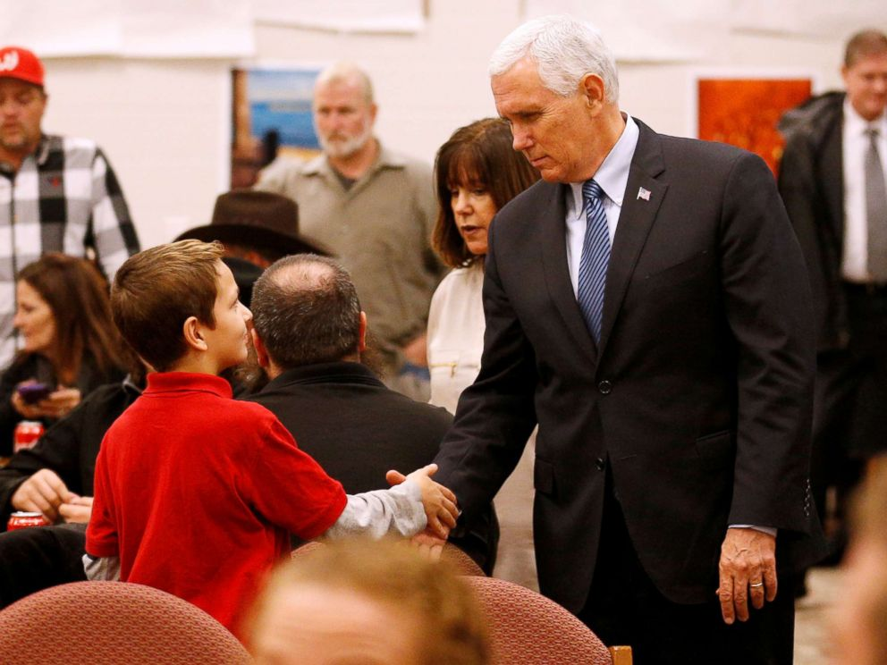 PHOTO: Vice President Mike Pence greets a young boy at Floresville high school during a visit with family and victims of the shooting at First Baptist Church in Sutherland Springs, before a vigil in Floresville, Texas, Nov. 8, 2017.