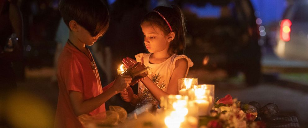 PHOTO: Lucrecia Martinez, 7, and her brother Luciano, 9, of Dickinson light candles during a vigil held in the wake of a deadly school shooting with multiple fatalities at Santa Fe High School on May 18, 2018, in Santa Fe, Texas.