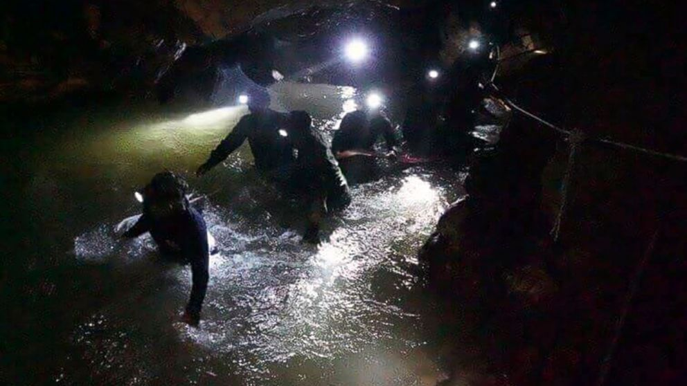 Thai rescue teams walk inside cave complex where 12 boys and their soccer coach went missing, in Mae Sai, Chiang Rai province, in northern Thailand, July 2, 2018.
