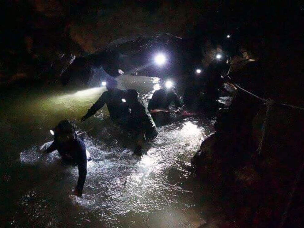PHOTO: Thai rescue teams walk inside the cave complex where 12 children and their soccer coach disappeared, in Mae Sai, Chiang Rai province, northern Thailand, July 2, 2018.